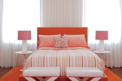 Colorful, modern bedroom: Pink + orange + white + Saarinen side tables