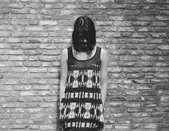 off the wall (maggyvaneijk) Tags: light blackandwhite brown brick wall digital garden hair mix dress arms head bare gray shapes down clash tiedye update tule tectures