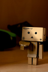 Danbo has a money. Wot i do wif it? (peachyboii) Tags: money macro canon eos 50mm gold amazon little coins box small cardboard sterling f18 figurine pound quid lightroom danbo 40d danboard cardbo 270ex