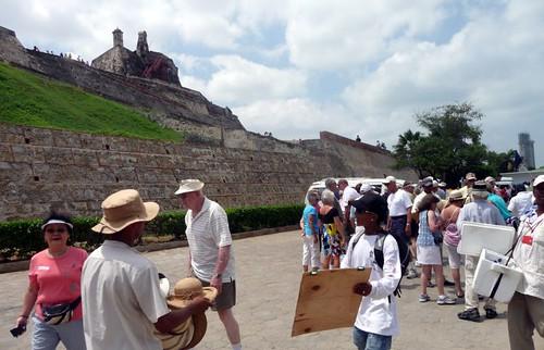 Tourists and street vendors at Ft. San Felipe