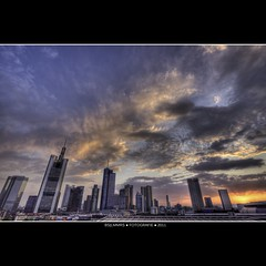 Frankfurt: Sunset after a glory day (Bas Lammers) Tags: cloud skyline architecture modern skyscraper canon germany deutschland colorful euro frankfurt wideangle colourful uitzicht 1022mm hdr architectuur kleurrijk groothoek 50d mygearandme mygearandmepremium mygearandmebronze mygearandmesilver mygearandmegold mygearandmeplatinum mygearandmediamond