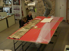 Conservation work on a section of a 19th photograph of the Bayeux Tapestry, February  2009.