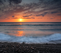 Sunset on Lanzarote (sdickie) Tags: longexposure sunset sea sky sun waves lanzarote pebbles f22 week9 25seconds dustspots gnd09 52themes