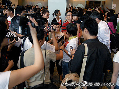 Lots of reporters and cameramen milling outside the conference hall
