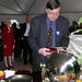 Dean Osborne samples some of Chef Legace's cooking