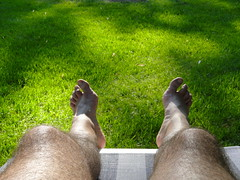 A Well Deserved Rest (lynn.h.armstrong) Tags: camera blue light brown white ontario canada green art feet grass lens geotagged photography photo chair long flickr shot legs photos sony south misc lounge tan cybershot lynn h etc rest miscellaneous armstrong lounger dsc stormont cyber gettyimages sault flickrcom ingleside superzoom attributionnoderivs redbubble redbubblecom ccbynd hx1 dschx1 lynnharmstrong requesttolicense requesttolicence