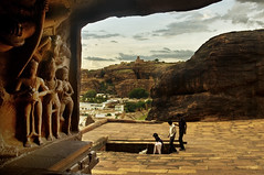 Badami Cave 3 looking outwards (Anoop Negi) Tags: red portrait bali india holiday tourism monument rock religious photography for photo sandstone media vishnu image photos cut delhi indian religion bangalore creative culture images canyon best caves po looks ritual cave shiva mumbai karnataka universe hindu hinduism nataraja epic anoop jain tale myth fable exciting badami chalukya negi bahubali jainism incarnation tandava striding photosof ezee123 bestphotographer vatapi imagesof anoopnegi trivakarma jjournalism