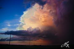 Incapable of Words (weather.chicka) Tags: blue sunset orange sun storm field clouds purple thunderstorm poles farmer shape