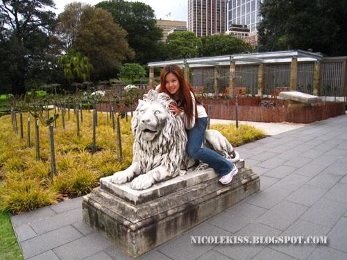 nicolekiss on lion statue