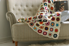 (sandra juto) Tags: home alpaca reading book crochet couch sofa blanket colourful johan myeverydaylife grannysquares