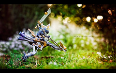 For Gnomeregan! (isayx3) Tags: flowers toy 50mm gnome nikon dof bokeh f14 worldofwarcraft figure warrior nikkor gnomes afd gnomeregan niftyfifty strobist mechnostrider