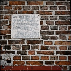 Vanished (bildministeriet) Tags: 6x6 tlr sign wall mediumformat square bricks gothenburg masonry analogue expired yashicamat unreadable fujicolornpz800 autaut lyckholms