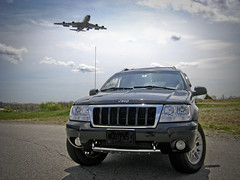 Jeep and plane (5six7 Photography) Tags: auto black grass metal clouds truck plane canon airport jeep cloudy military newengland newhampshire sunny landing chrome pointandshoot ang fuel pease airnationalguard kc135 grandcherokee stratotanker touchandgo refuelingplane sd800is canonites