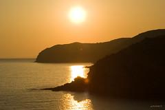 Sunset in Limnia (Scor-pio) Tags: sunset water yellow greece chios theworldwelivein a350 bej aplusphoto platinumheartaward limnia theperfectphotographer qualitysurroundings waterenvirons beachesallovertheworld