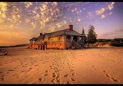 Ludington Beach House at Sunset (Craig - S) Tags: blue sunset sky orange white beach clouds golden sand glow stones footprints lakemichigan windswept ludingtonstatepark ludingtonmichigan platinumheartaward ludingtonbeachhouse