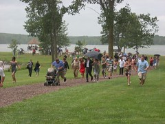 Wedding Attendees Run from the Rain