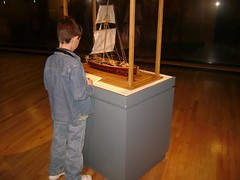 a boy at the museum (JaiHoTwit) Tags: new wood york boy museum floors boat model ship display little military saratoga sails springs
