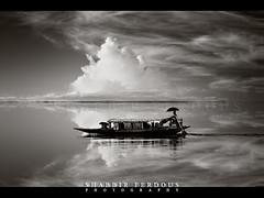 Under the beautiful sky (Shabbir Ferdous) Tags: sky people blackandwhite cloud reflection water monochrome landscape boat photographer shot tone sylhet bangladesh bangladeshi canoneos5d ef70200mmf28lisusm shabbirferdous tangorhawor wwwshabbirferdouscom shabbirferdouscom
