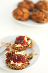Scottish Wholewheat Oatmeal Barley Current Scones Slathered with Double Cream and Raspberry Jam