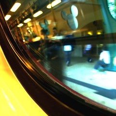 INSIDE/OUTSIDE (ringo01_hk) Tags: window station digital train canon hongkong graphics metro disneyland rail railway railwaystation lonely express  tone 60 mtr ixy afternnoon greentone hongkongphotos canonixydigital60 spiritofphotography
