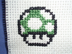 cross shroom (acme01) Tags: green mushroom crossstitch stitch nintendo mario pixel unfinished nes gamecube snes n64 supermario wii