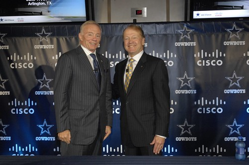 Cisco CEO John Chambers and Dallas Cowboys owner Jerry Jones shake hands at a press conference at the new Dallas Cowboys Stadium to announce the Cisco technology deployment