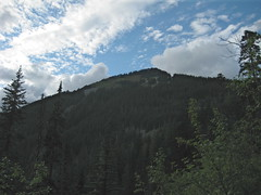 Defiance summit from the talus field just below Mason Lake. The trail begins traversing the summit near the notch in the trees just below and to the right of the summit