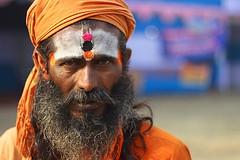 sadhu | Kolkata (arnabchat) Tags: portrait india face look eyes bokeh kolkata bengal calcutta bangla pilgrim sadhu sankranti westbengal 50f18 makarsankranti arnabchat arnabchatterjee gangasagartransitcamp