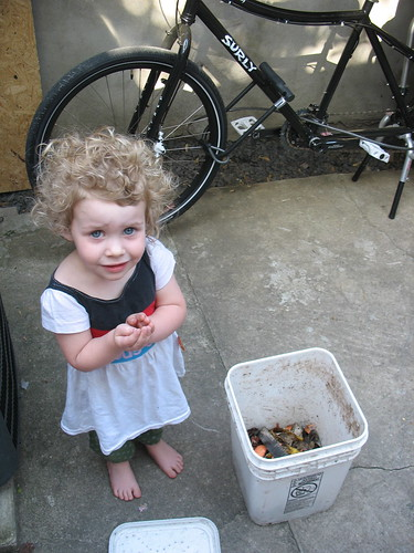 Holding her composting worms