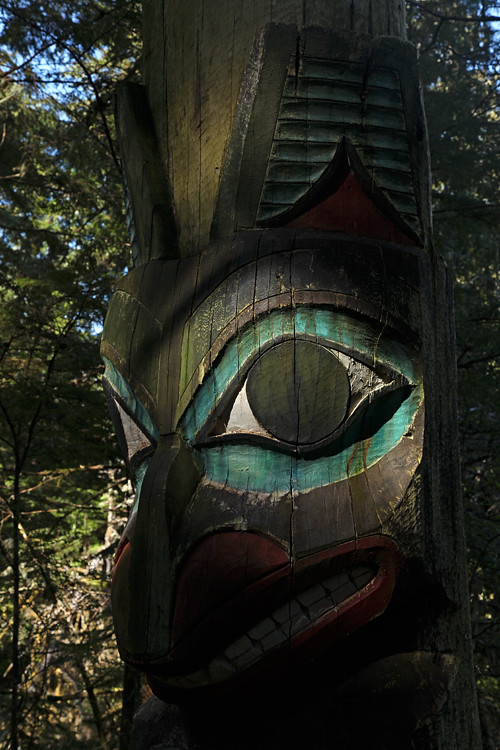 bear memorial totem in shadow, Totems Historic District, Kasaan, Alaska