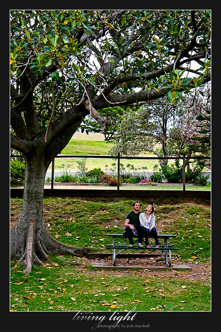 King Edward Park, Newcastle. Couple sitting on the picnic table under a tree.