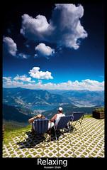 Relaxing (Hussain Shah.) Tags: blue sky clouds d50 austria nikon couple chairs relaxing sigma 1020mm zellamsee shah hussain watcging
