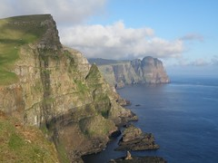 Eggjarnar in the Faroe Islands - View towards Beinisvr (Eileen Sand) Tags: eggjarnar skvanes faroes faroeislands froyar frerne nature suuroy suduroy north atlantic ocean beinisvr landscape seascape birdcliffs seastacks beautifulshot platinumheartaward   frsaaret frer inseln lesfro freyjar faerer isole frer faroeadalar   frarna fryene      worldtrekker europe    voyage  europa  havet mar  meri sea flickrhivemind cliffsworld view steep beautiful great foroyar eileensand giantcliffs westcoast coast coastline verticalcliffs northatlantic atlanticocean island cliffs cliffsofthefaroeislands cliffsofsuduroy islasferoe islands grandcanyonoftheseas