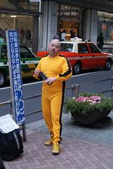 Anybody thinking Kill Bill ? (drew*in*chicago) Tags: street man yellow japan tokyo taxi performance moustache suit confused charliebrown mustache cameltoe chucks killbill louisvuitton nunchucks numchuks nunchukas chainsticks bruceleewannabee drewinchicago