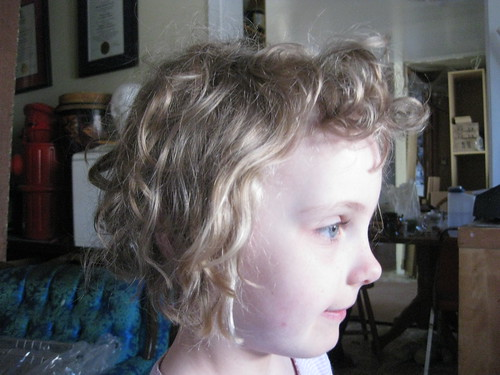 curls from the side.