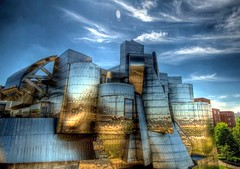 Art follows Nature (Mandana (on and off)) Tags: abstract motion reflection art minnesota metal museum architecture clouds canon reflections golden raw glow shapes minneapolis wideangle surface structure plastic form organic frankgehry 2009 hdr weismanartmuseum fluidity deconstructivism photomatix singleshothdr cs3canon