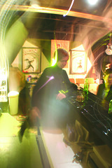 Erica Case tends the Alchemist Theatre and Lounge's bar. ~ photo courtesy Alchemist Theatre
