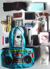 What's in my bag? (Hippy of Doom) Tags: gum bag keys perfume phone wallet turquoise hellokitty zuma gloves purse nintendods mp3player receipts lipgloss whatsinmybag satnav proplus loopghettoblaster
