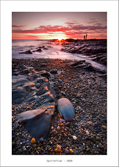 Rocks & Rays (Spiritflier) Tags: longexposure sea sky people beach wales clouds canon fishing rocks westwales tide horizon sigma pebbles erosion shore 1020mm ceredigion manfrotto cokin ndgrad eos40d spiritflier simoore