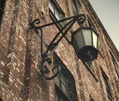Old lantern  DSCN0131 (Lanterna) Tags: city nyc urban newyork brick lamp buildings industrial factory wroughtiron 19thcentury westvillage lantern lanterna greenwichvillage 11thst