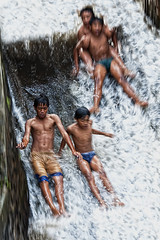 Water Fun Series - Four at a time (Mio Cade) Tags: travel boy shirtless bali boys water kids swim indonesia fun four photography waterfall kid village slide ubud abangan