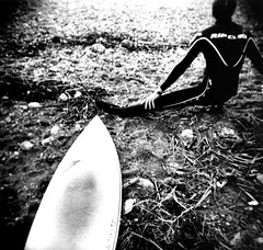 Banzai Beach (massi_pugliese) Tags: sea blackandwhite bw italy mer white black 120 6x6 film beach square holga lomo lomography surf italia mare waves kodak stones surfer toycamera grain surfing 66 bn pietre squareformat analogue sassi bianco blanc nero spiaggia bianconero negre quadrato onde 400iso santamarinella grana palabra pellicola kodaktrix400 analogico medioformato bwart nearrome autaut banzaibeach ilfordwarmtone cartabaritata massimilianopugliese massipugliese