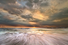 sunset, sea and clouds (tropicaLiving - Jessy Eykendorp) Tags: light sunset sea sky bali seascape motion beach nature water clouds indonesia coast rocks shoreline wave efs1022mmf3545usm outdoorphotography canoneos50d tropicaliving
