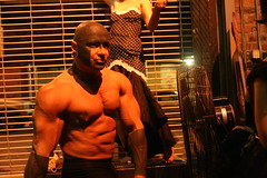 Strongman (rightsandwrongs) Tags: muscles tattoo brooklyn circus strongman facialtattoo