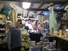 Charity shop interior (wonky knee) Tags: uk shropshire display shrewsbury redcross charityshop thriftshop aladdinscave