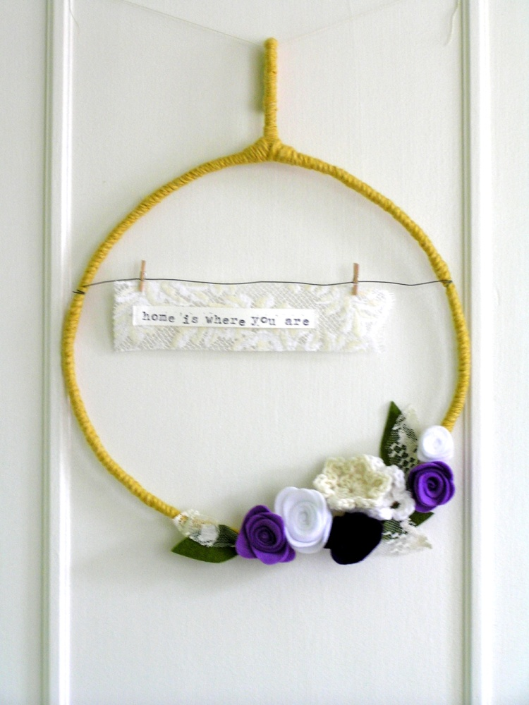 home is where you are - yarn wreath in mustard, purples, white, and ivory
