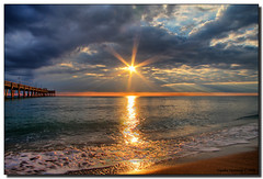 A Star is Born (Fraggle Red) Tags: ocean light sun beach water clouds sunrise dark star sand surf searchthebest bright florida hollywood northbeach rays jpeg atlanticocean soe hdr daniabeach blueribbonwinner canonefs1785mmf456isusm 3exp mywinners abigfave shieldofexcellence daniabeachpier anawesomeshot browardco dphdr goldstaraward rubyphotographer guasdivinas