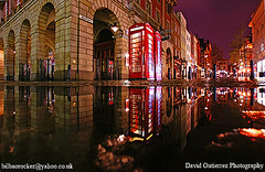 London Rain at Night ....in Covent Garden~~~~ (david gutierrez [ www.davidgutierrez.co.uk ]) Tags: road street new city uk travel winter urban house storm flower reflection london westminster rain weather st fruit architecture night strand corner shopping garden 1974 interestingness high opera cross market streetperformers camden sony soho nine entrance royal vegetable east entertainment covent holborn bloomsbury londres area charing coventgarden nights borough piazza alpha heavy performers londra kingsway wholesale jamess southwestern elms municipality cubism dominated blueribbonwinner sonyalpha theunforgettablepictures rubyphotographer sonydslra350 sony1118mm sonyalphadslr350 sonyalphadt1118mmf4556lens anditcontainsanentrancetotheroyaloperahouse sony350dslra350