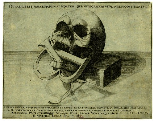A Skull balanced against a stone block; the letters LB intertwined with the jaw