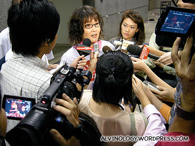 The new AWARE president, Ms Dana Lam, bombarded by the media